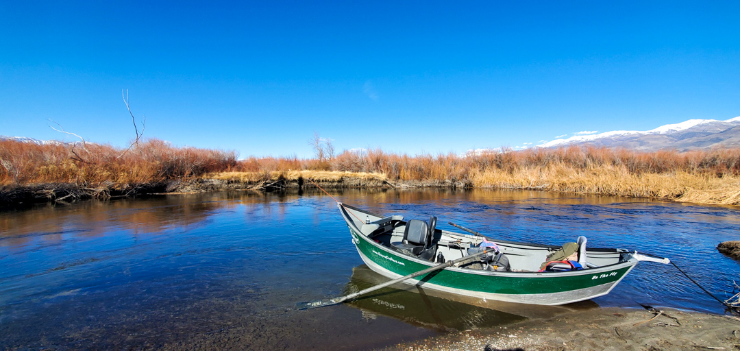 A drift boat from an Eastern Sierra Fishing Guide on the banks of the Lower Owens River near Bishop, CA.