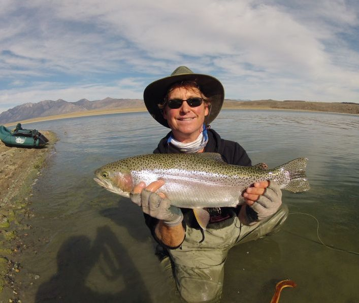 Chris Basso Sierra Drifters with a huge rainbow he caught on the fly on Crowley Lake