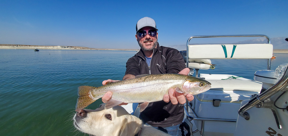 A fly fisherman displays a cutthroat trout from Crowley Lake with Sierra Drifters Guide Service
