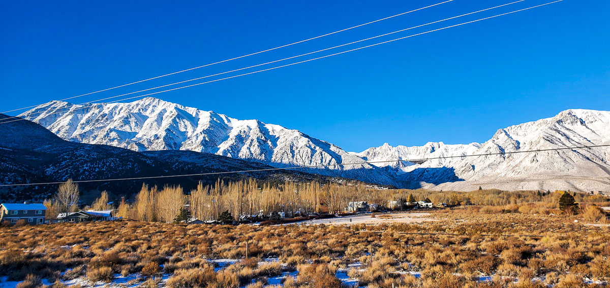 Community of Crowley Lake and McGee Mountain with fresh snow capped mountains and clear skies