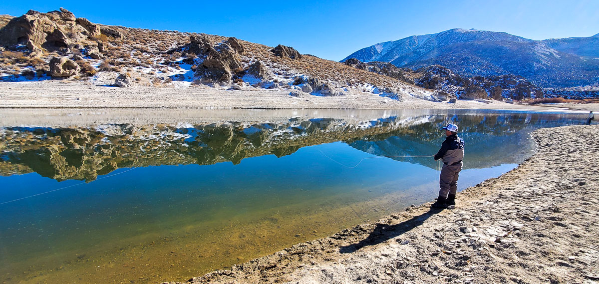 A fly fisherman fishing on Crowley lake in early November.