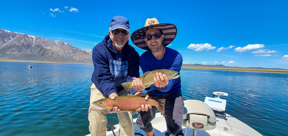 A pair of fly fishermen with a double hookup on brown and cutthroat trout on Crowley Lake.